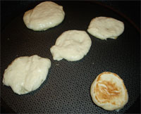 Blinis in frying pan