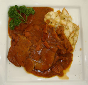 Wild Boar in juniper sauce with bread dumpling